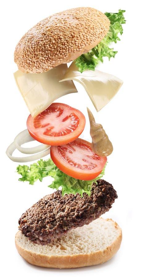 hamburgerów latający składniki zdjęcie stock