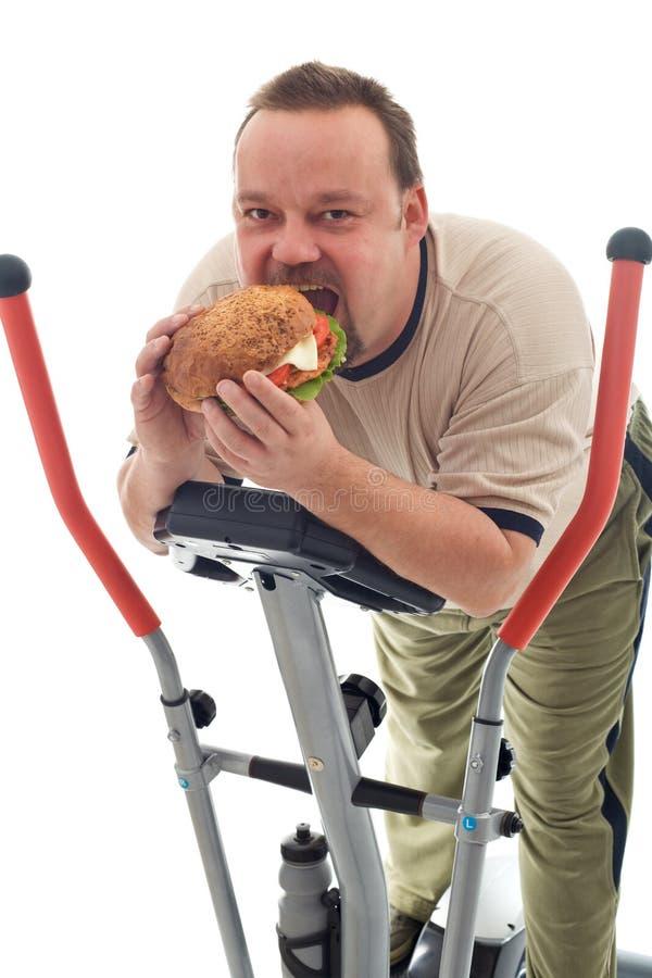 Hamburger énorme mangeur d'hommes sur un dispositif d'avion-école photographie stock libre de droits