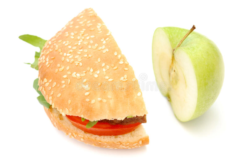 Hamburger and apple stock photography