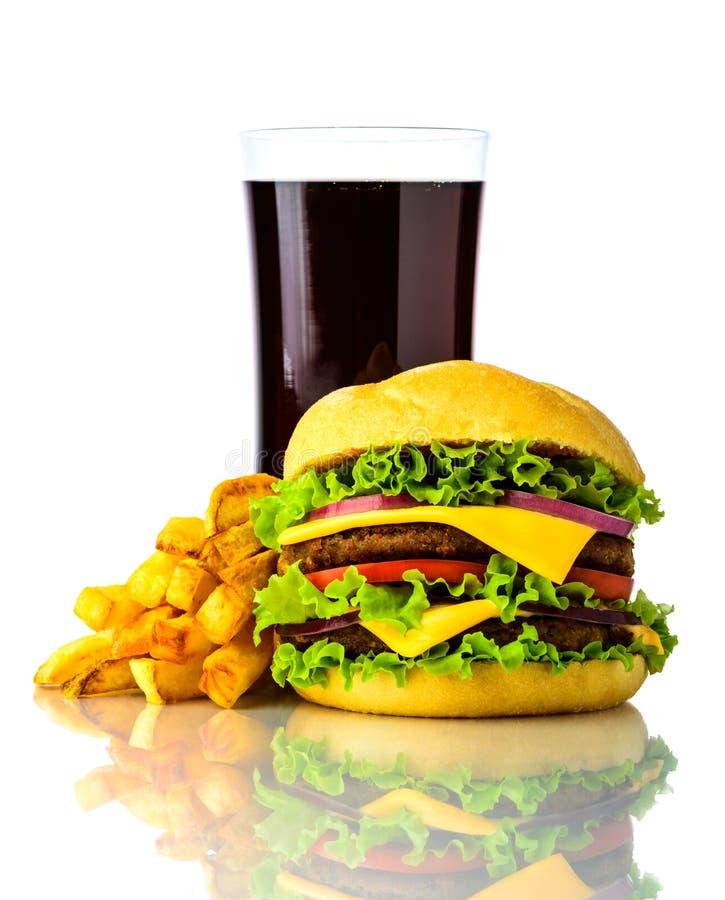 Hamburger, batatas fritas e bebida imagem de stock royalty free