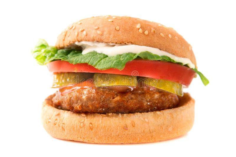 Hamburger with cheese, bacon, tomato and lettuce on white background royalty free stock photo
