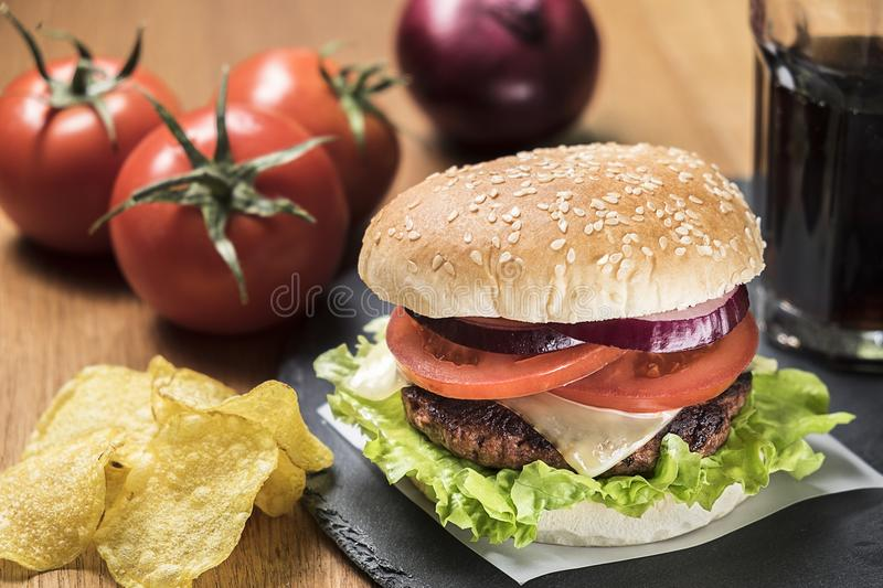 Hamburger with chips and cola stock photos
