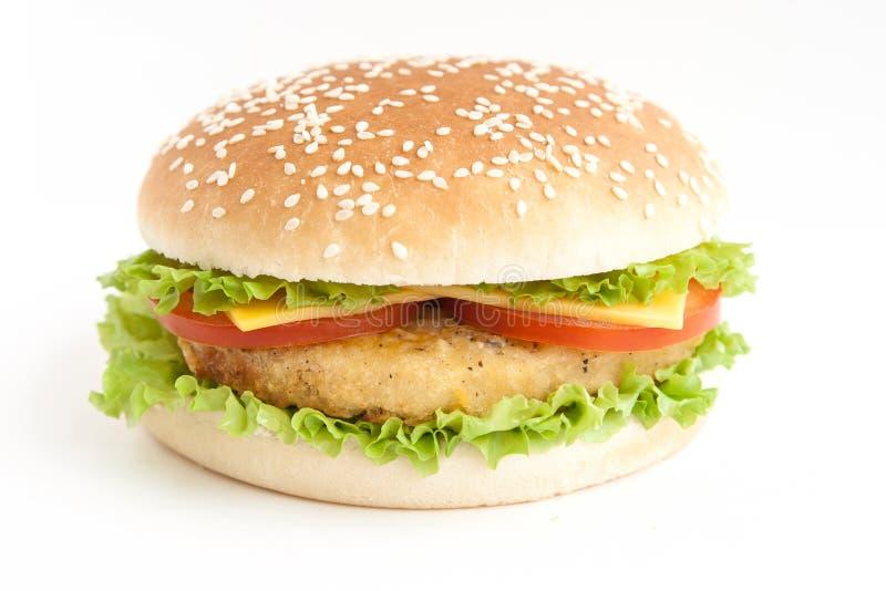Hamburger com costoleta e vegetais foto de stock
