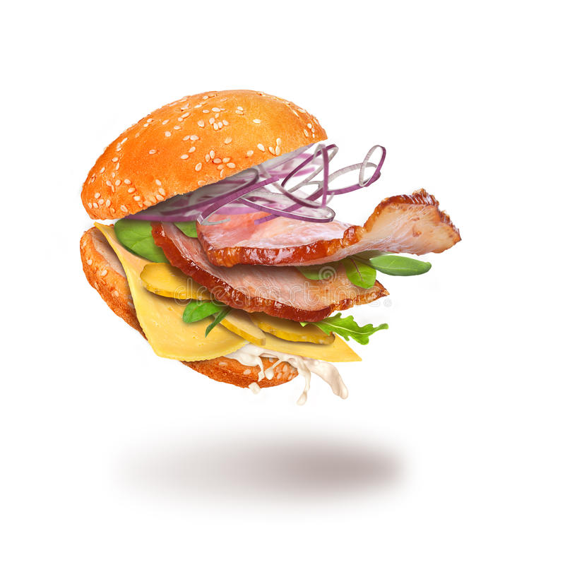 Hamburger com ingredientes do voo fotos de stock royalty free