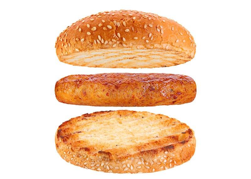 Hamburger d'ingrédient de petit pain et de rissole de poulet photographie stock libre de droits