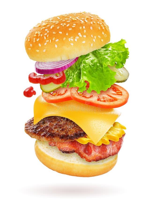 Hamburger de vol d'isolement photo stock
