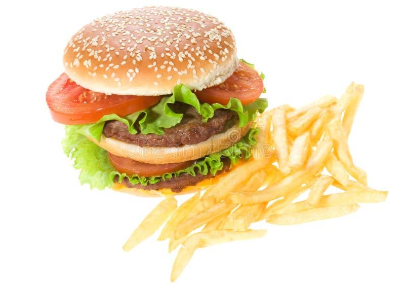 Hamburger dobro com vegetais e fritadas foto de stock royalty free