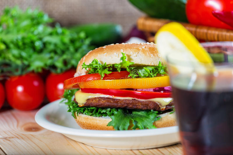 Hamburger and drink. With slice of lemon stock photo