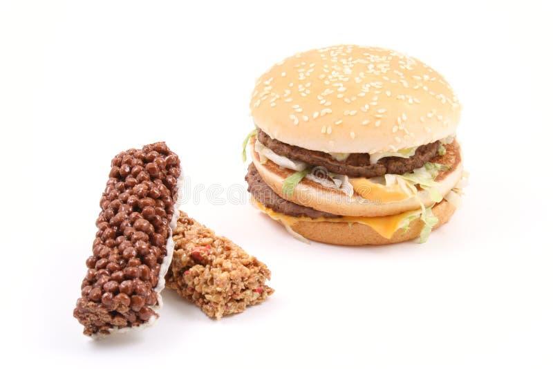Hamburger e petisco deliciosos fotografia de stock royalty free