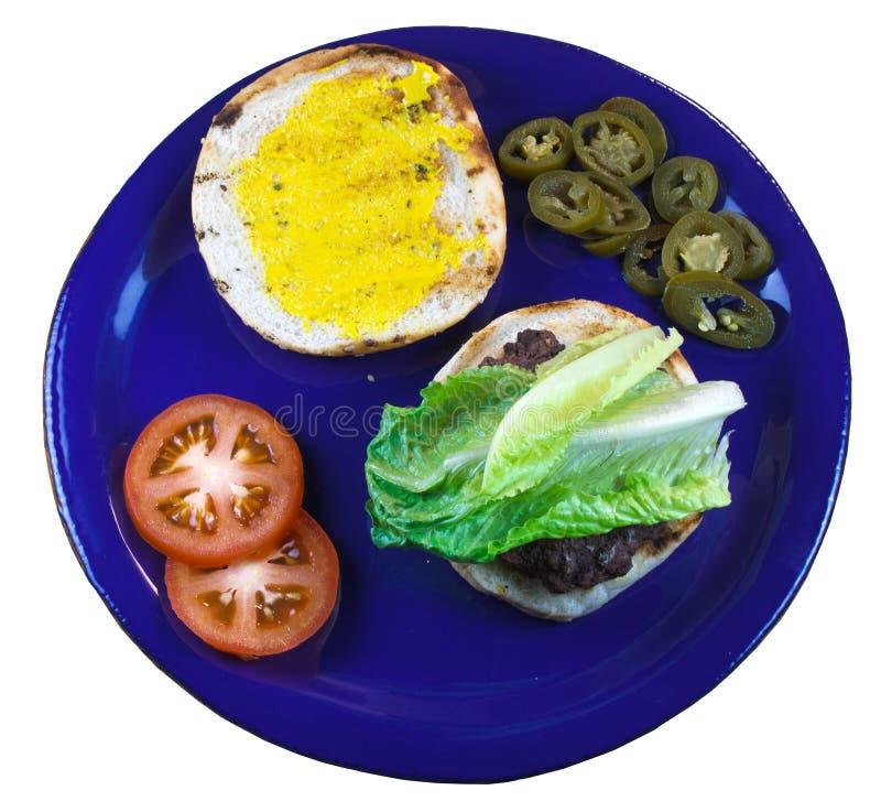 Hamburger et fixations photographie stock