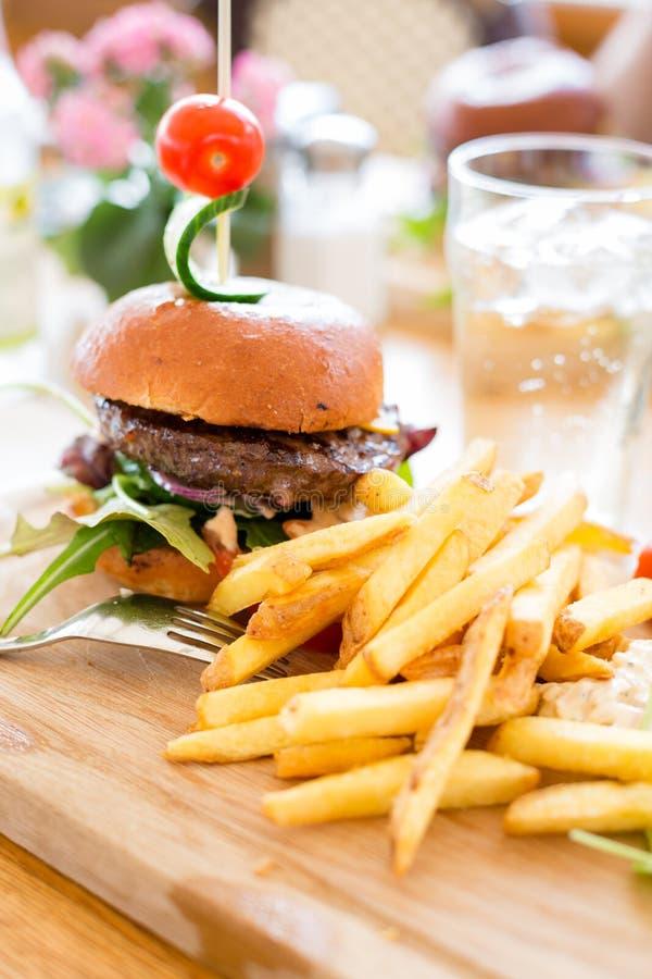 Hamburger with fries. stock image