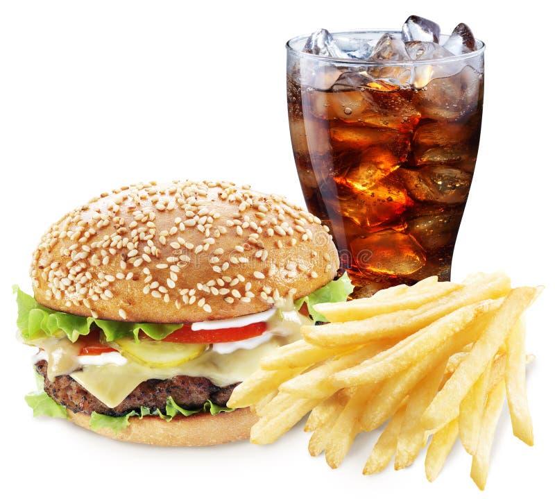 Hamburger, grula dłoniaki, kola napój Takeaway jedzenie fotografia stock