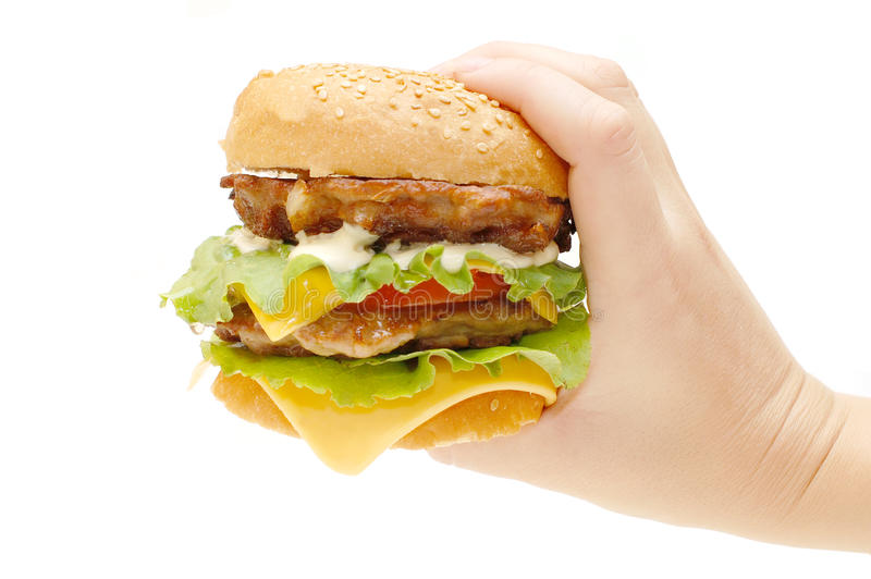 Hamburger in a hand stock photos