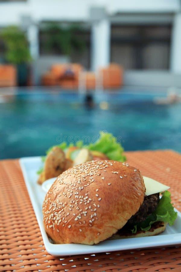 Hamburger At Hotel Pool Royalty Free Stock Photos