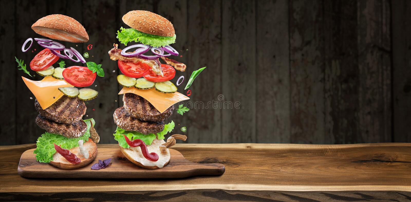 Hamburger ingredients falling down one by one to create a perfect meal. Colorful conceptual picture of burger cooking stock photos