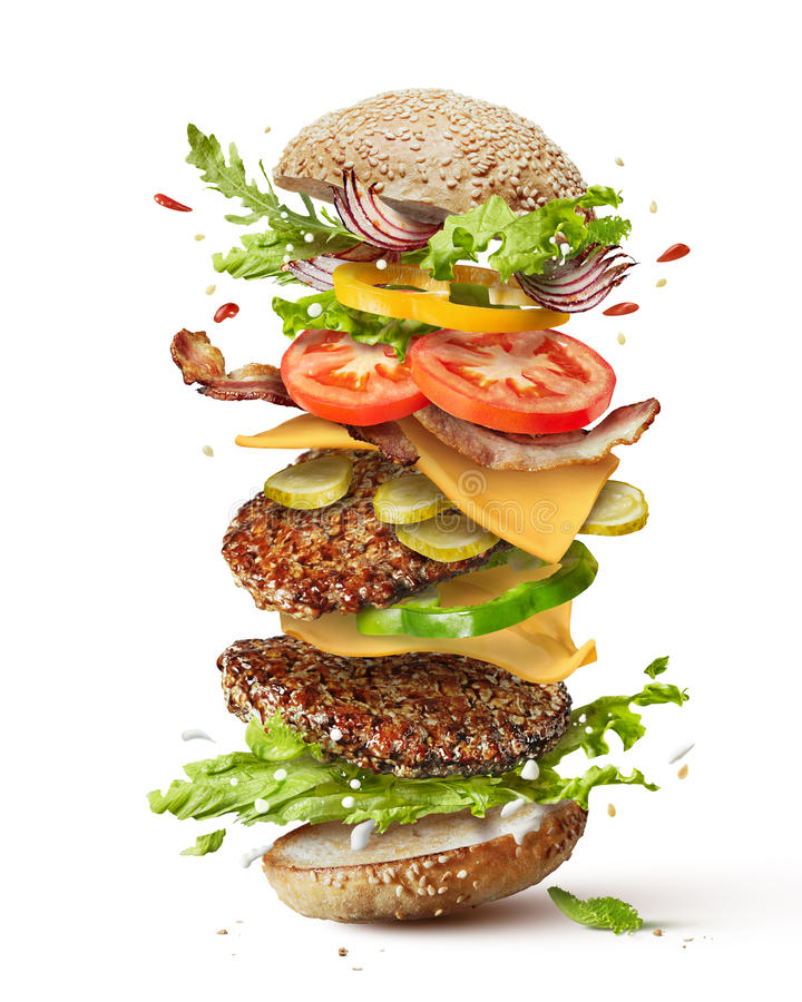 Hamburger met vliegende ingrediënten royalty-vrije stock afbeeldingen
