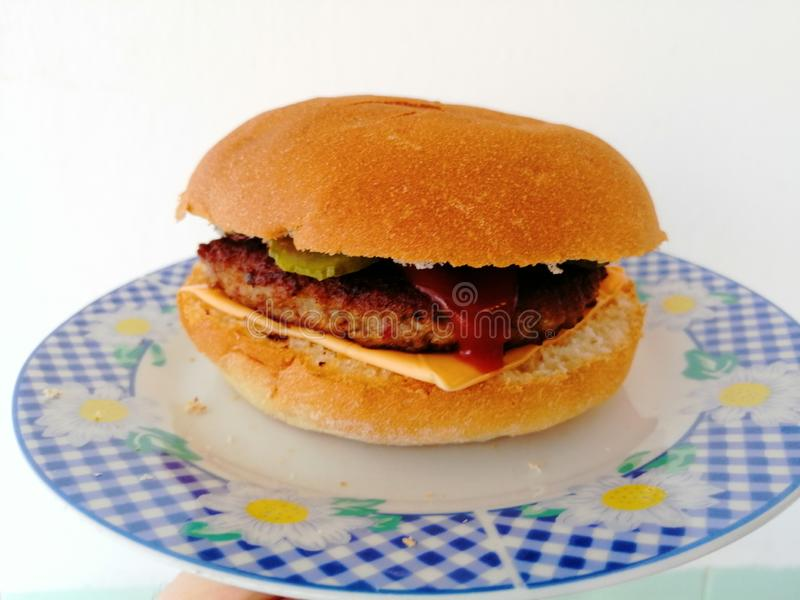 Hamburger. Picture of hamburger on gray platehamburger is a sandwich consisting of one or more cooked patties of ground meat, usually beef, placed inside a stock photo