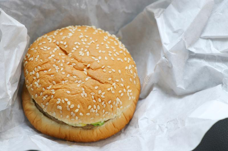 The hamburger is placed on white paper. stock images