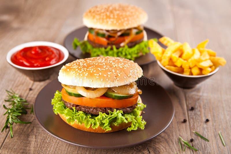 Hamburger with potato chips royalty free stock photo