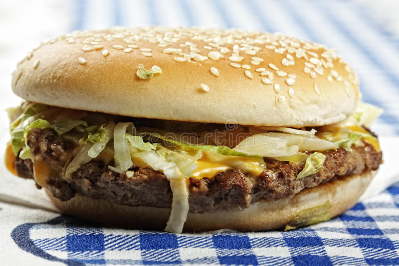 Hamburger On Tablecloth Sideview Stock Image