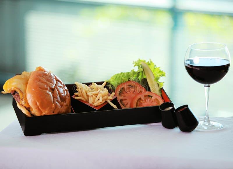 Hamburger and Wine stock photos