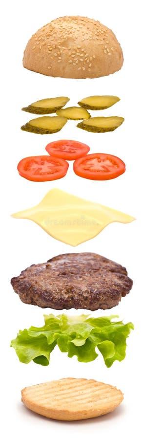 Hamburger zerteilt vertikale Explosion stockfotos
