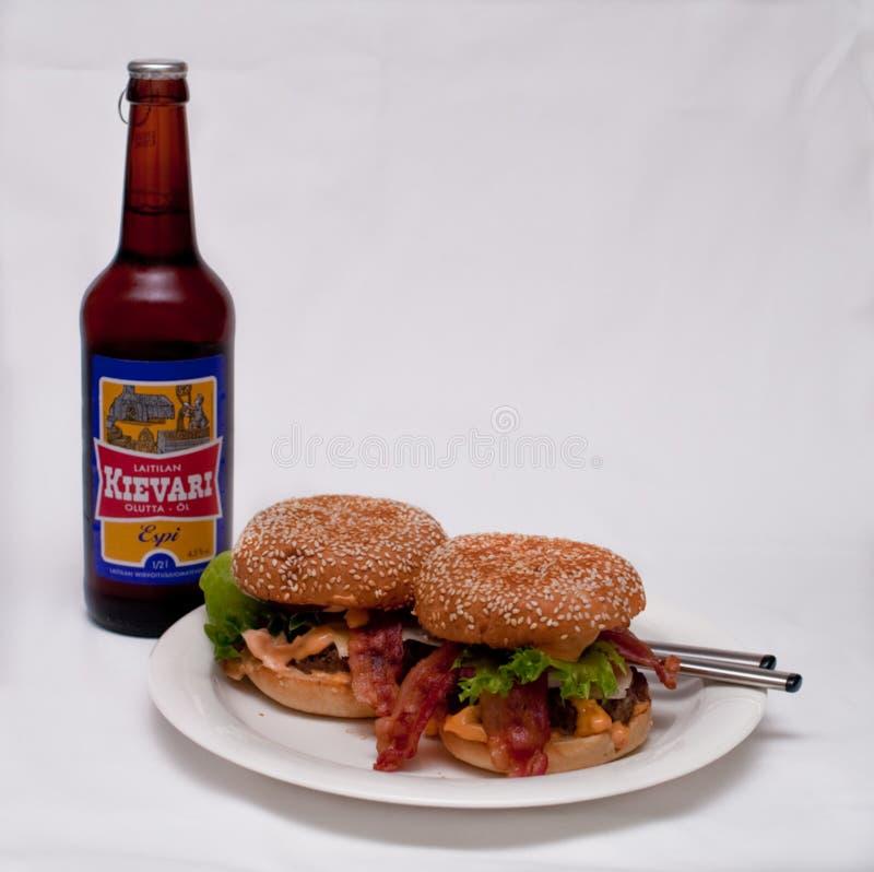 Hamburgers and beer royalty free stock photography