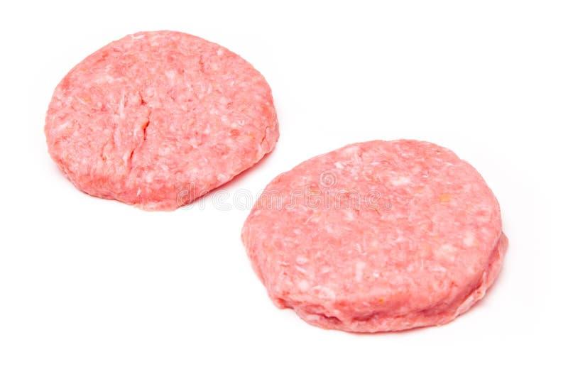 Hamburgers de viande de crocodile d'isolement sur un backgr blanc de studio images libres de droits