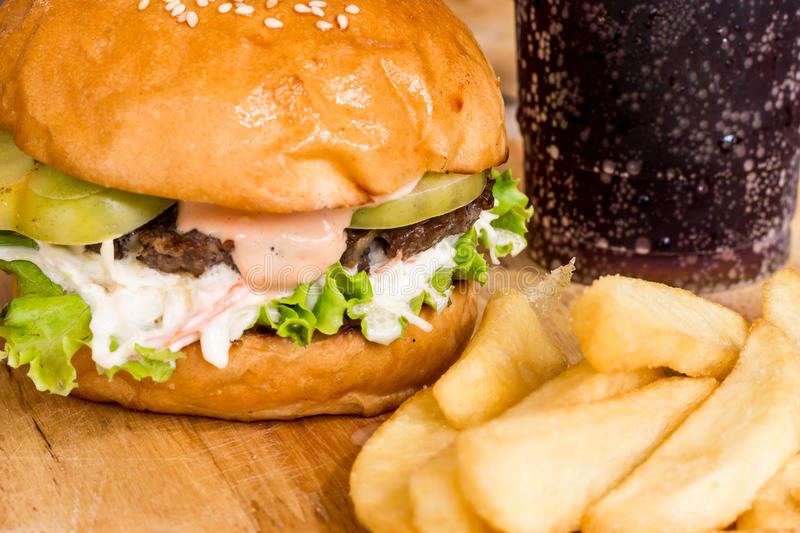 Hamburgers and French fries on the wood. royalty free stock photo
