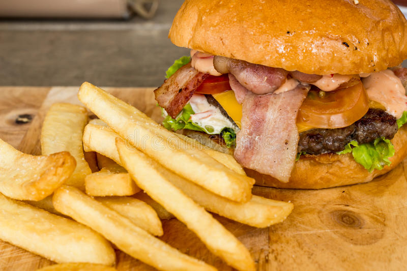 Hamburgers and French fries on the wood. royalty free stock photography