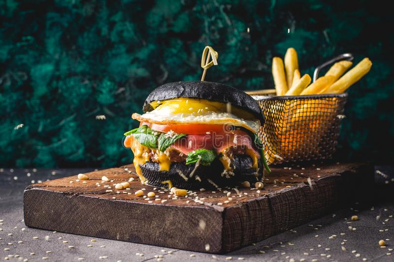 Hamburgers and French fries on the wooden tray royalty free stock photos