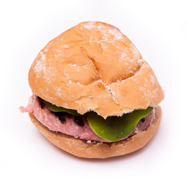 Hamburgers grillés de viande de crocodile d'isolement sur un backgr blanc de studio images libres de droits