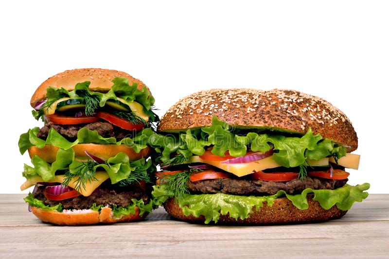 Hamburgers for a hearty dinner on an isolated white background royalty free stock photography