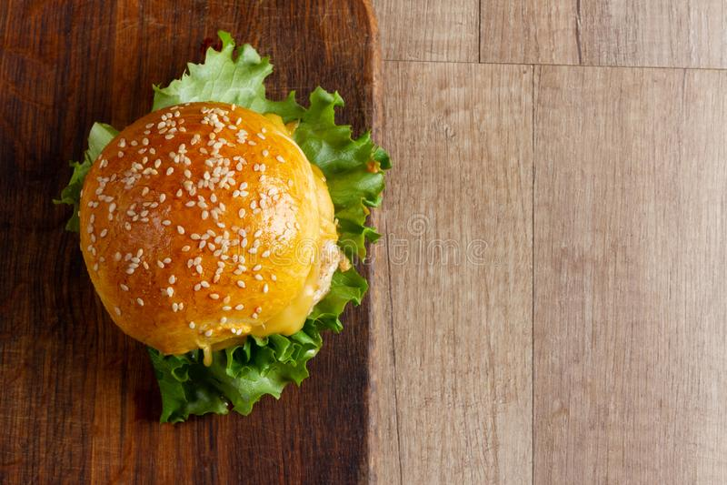 Hamburgers on a wooden board copy space stock photography