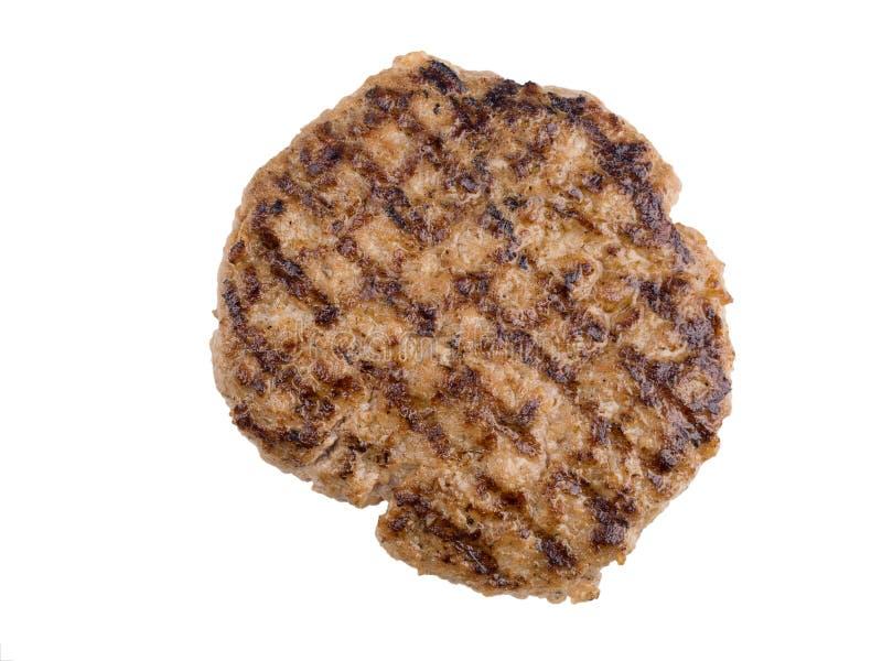 Hamburgerslapje vlees op de witte achtergrond met het knippen van weg wordt geïsoleerd die stock foto