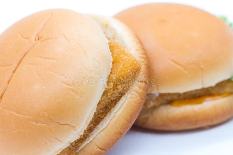 Hamburgeru zbliżenie na białym tle zdjęcia royalty free