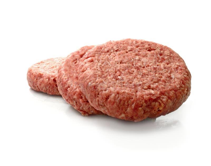 Hamburgueres crus da carne fotografia de stock royalty free