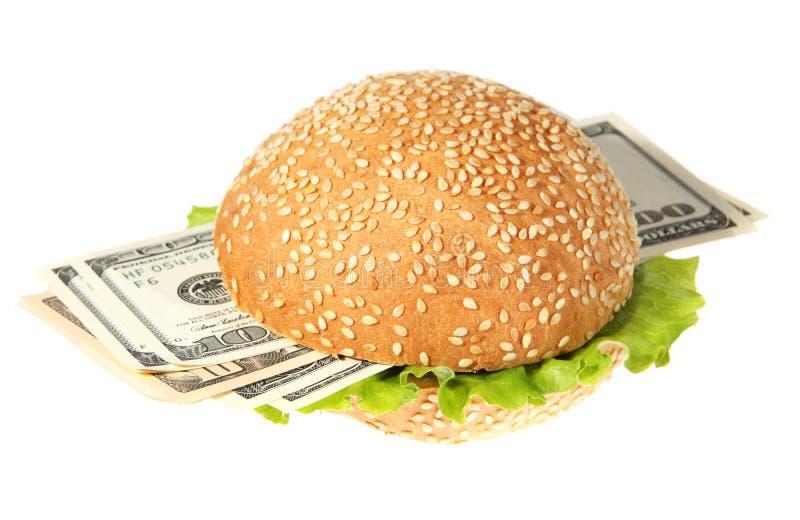 Hamburguesa con el dinero en el blanco foto de archivo