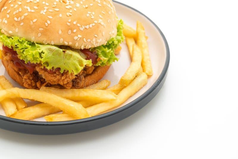 hamburguesa del pollo frito aislada en el fondo blanco fotografía de archivo libre de regalías