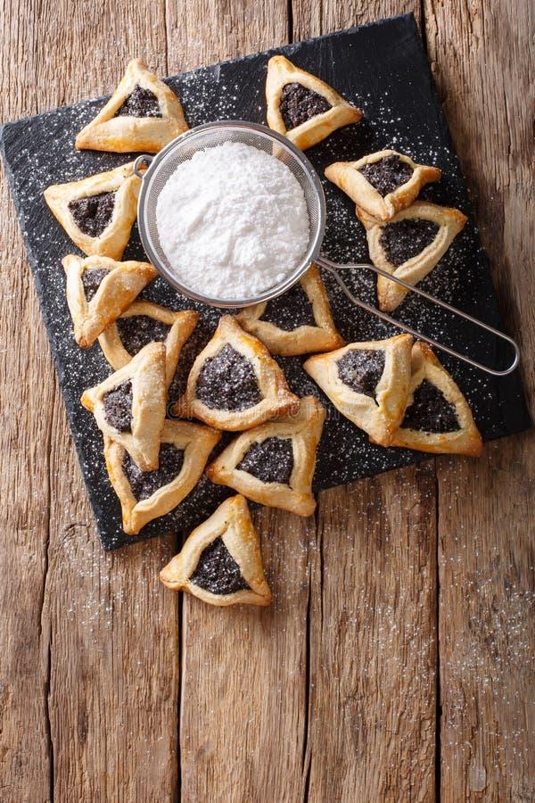 Hamentashen semestrar triangulära kakor med vallmofrö för Purim royaltyfri foto