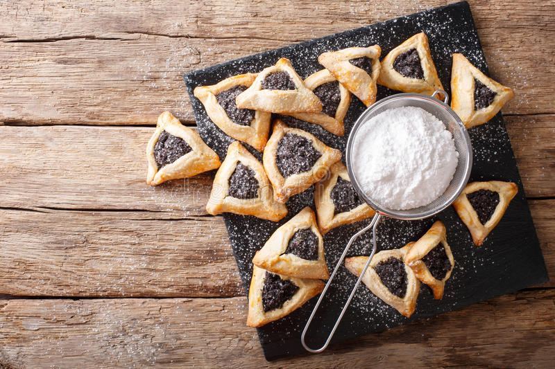 Hamentashen triangular cookies with poppy seed for Purim holiday stock images