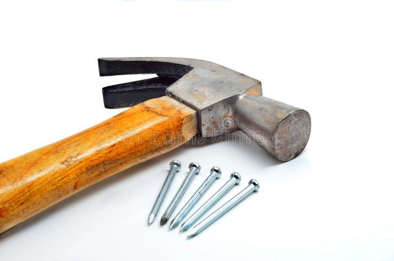 Hamer en weinig spijkers stock afbeelding