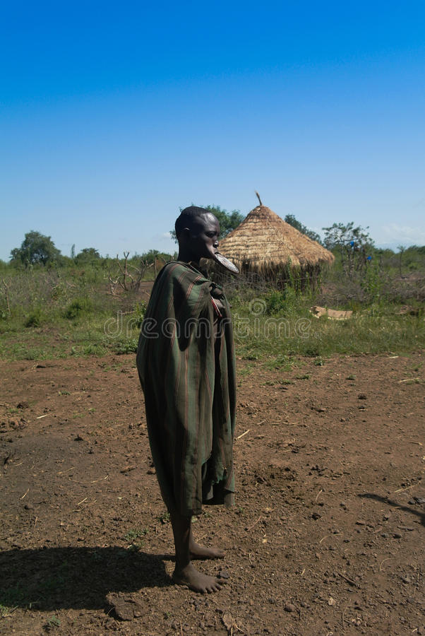 Mursi tribe woman - 05 october 2012 , Omo valley, Ethiopia royalty free stock photography