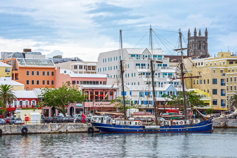 Hamilton Bermuda Seaport. HAMILTON,BERMUDA, MAY 25 - An old tall ship and colorful buildings are typical of the view on May 25 2016 in Hamilton,Bermuda stock photo