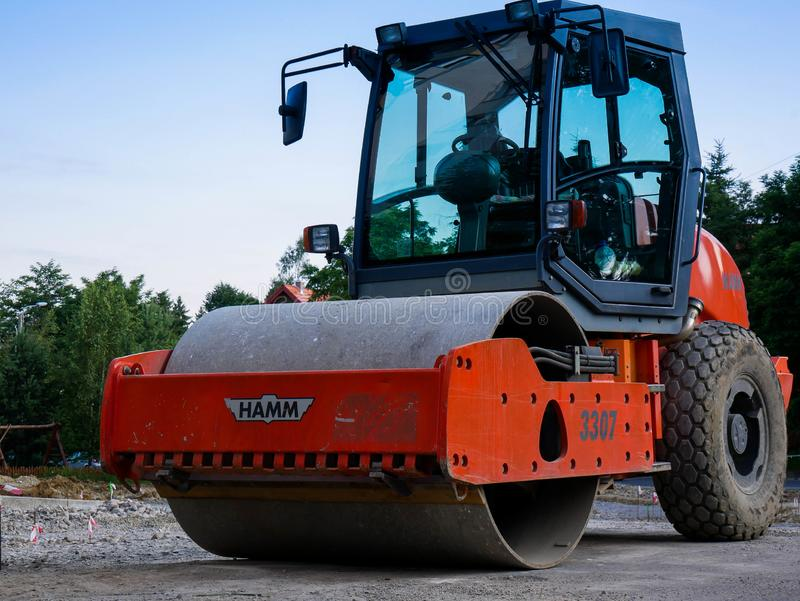 Hamm road roller on street construction site in the morning. Miercurea Ciuc, Romania- 13 July 2019: Hamm road roller on street construction site in the morning stock photo