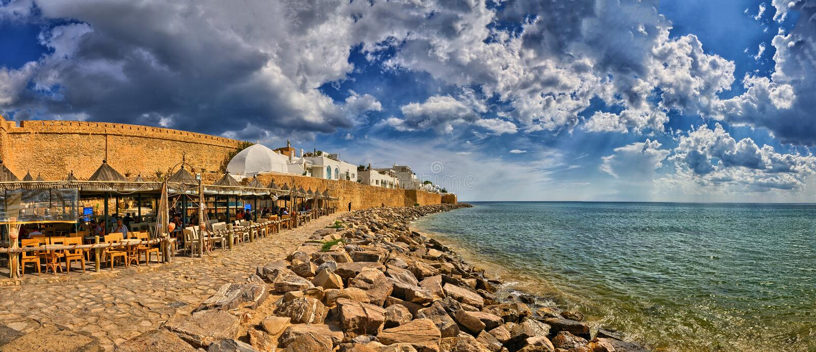 HAMMAMET, TUNISIA - OCT 2014: Cafe on stony beach of ancient Med. Ina on October 6, 2014 in Hammamet, Tunisia royalty free stock photography
