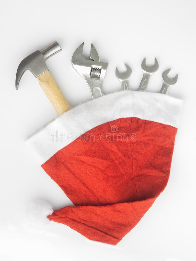 Hammer, adjustable wrench, wrenches in Santa Hat. Handy tools in Christmas festival background concept.  stock photos