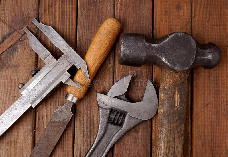 Hammer and caliper. Old tools royalty free stock image