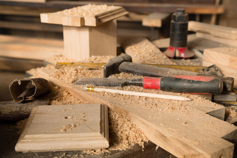 Hammer and chisel on the bench. In the carpentry workshop royalty free stock photos