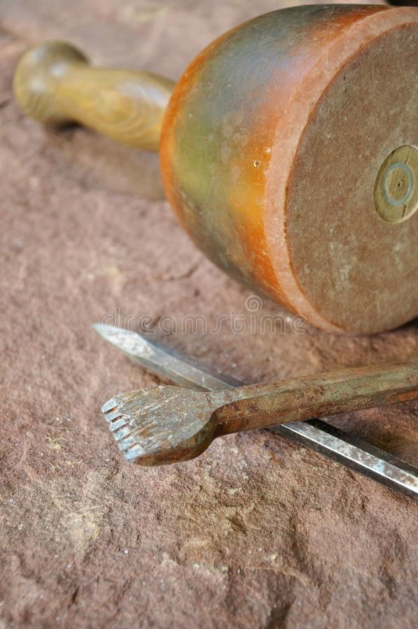 Hammer and chisel. Tool, hammer and chisel, of an stonemason lays on a stone stock photo